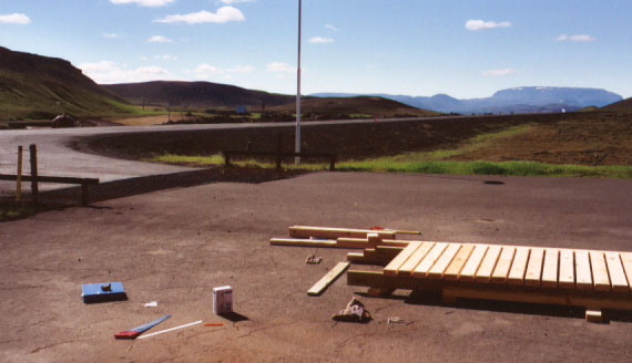 This is in the parking lot of Krafla, a geothermal power plant. We built footbridges here to be placed through Leirhnjúkur, a nearby geothermal area like Hverir. The existing path goes through the hot areas and becomes slippery when it rains. Careless people do get badly burned there. The plan is to reroute the path around the hot spots with footbridges leading up to a viewing platform, so that people can see the area without walking through the center of it.