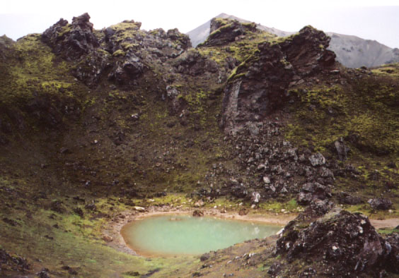 Craggy lava and greenish water... seems like something out of Lord of the Rings.