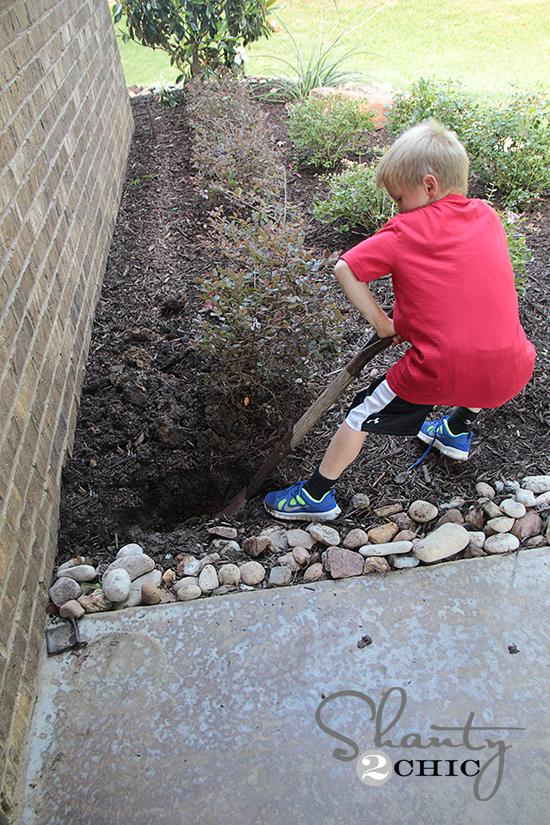 Dig hole for hose holder