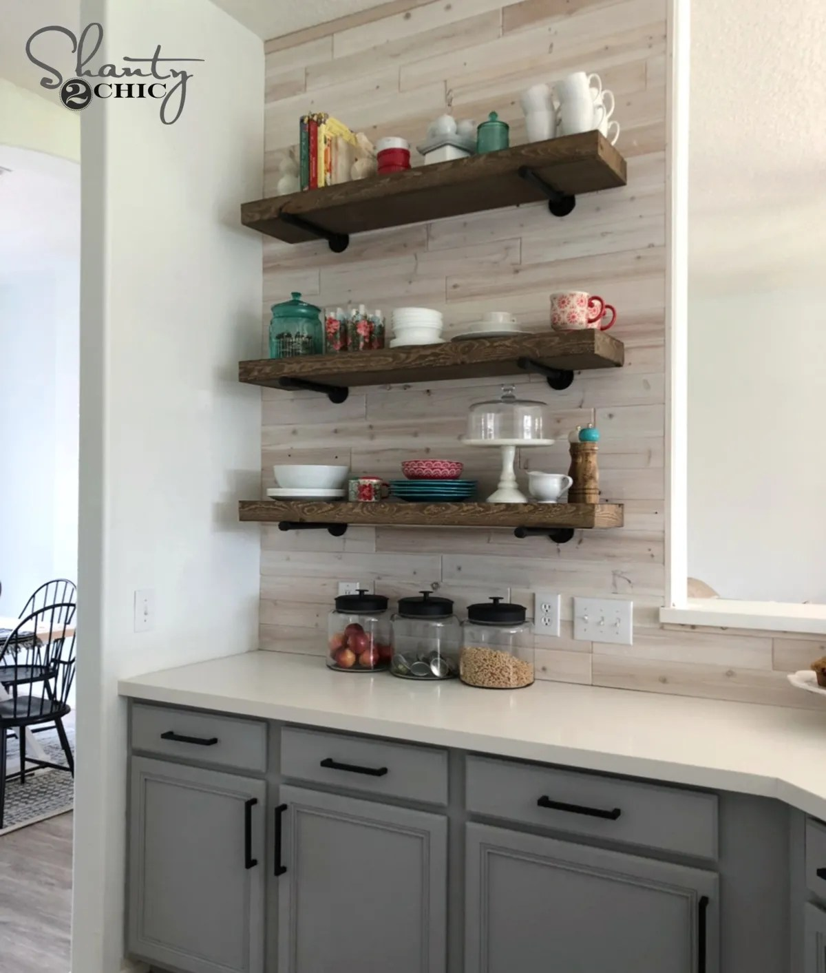 DIY Floating Shelves with Pipe - Shanty 2 Chic