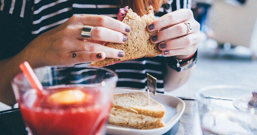 woman-eating-sandwich-food-homrone-imbalance.jpg