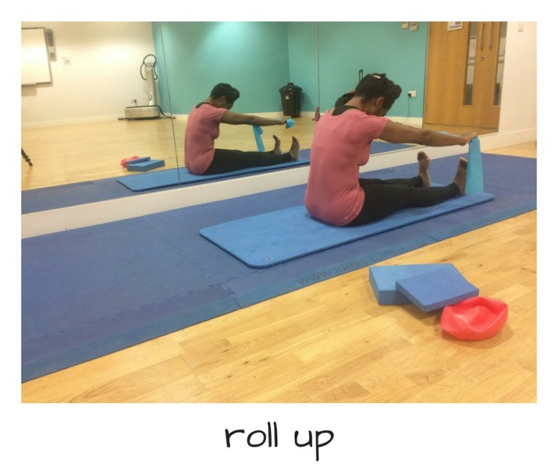 Pilates roll up exercise