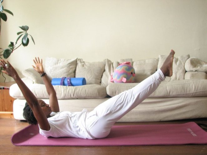 Flat belly Pilates exercise double leg stretch