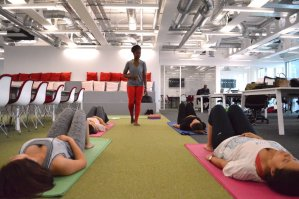 Corporate yoga and Pilates class in office