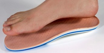 Foot hovering over insoles