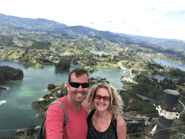 Matt and Sharon standing on top of El Peñon rock, Colombia