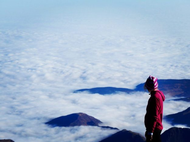 Standing above the clouds on the summit of Mount Toubkal