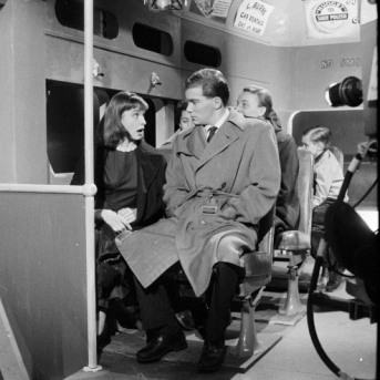 Shatner and Janet Reid talk on a streetcar.