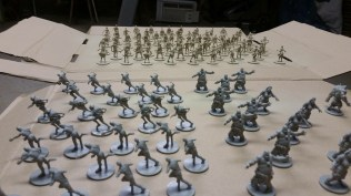 Unpainted figurines in front, primed in back