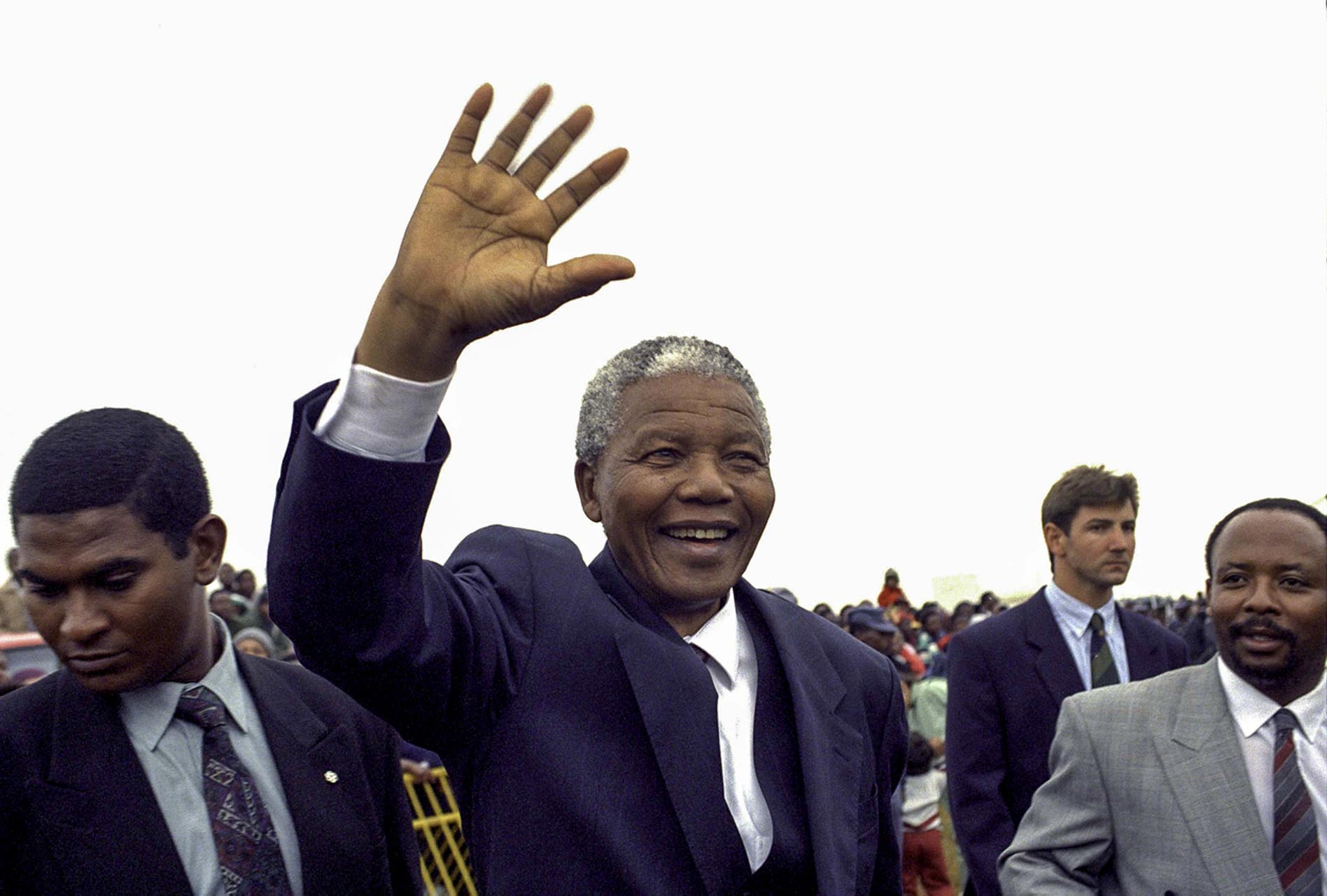 20031208SH37: President Nelson Mandela gives a wave while leaving Avalon cemetery. Before shaking the hands of some of the survivors of the SS Mendi ship disaster, while attending the 82nd commemoration of SS Mendi at the Avalon Cemetary. The SS Mendi was a steamship that was sunk in 1916  while transporting soldiers to France during the world war one, 646 soldiers died and 607 among the dead were African. (Photo