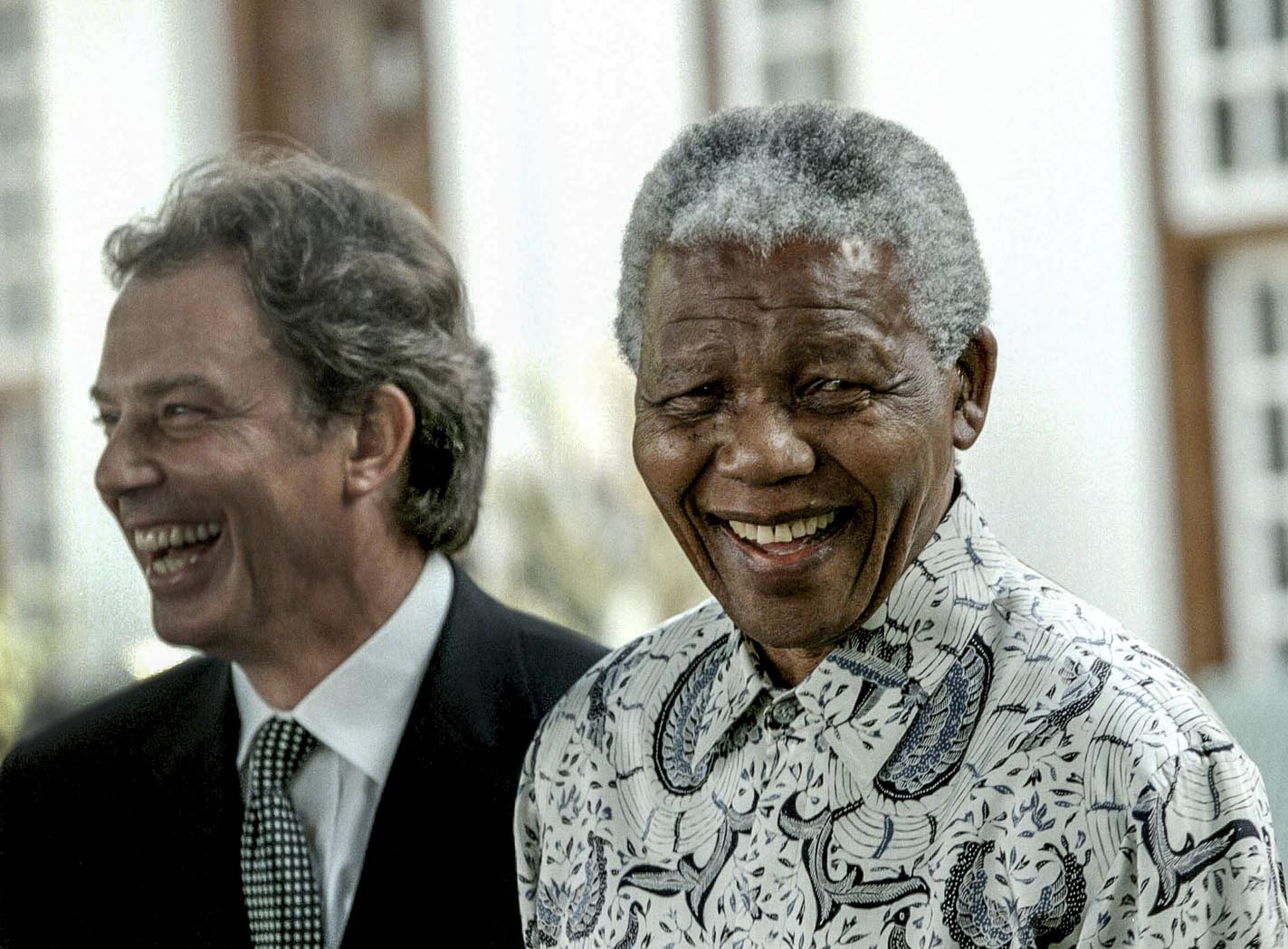 990108SH11:SAFRICA:GOVERNMENT:PERSONALITY:JAN99 - President Nelson Mandela laughing with British Prime Minister Tony Blair at a press conference at Mahlamba Ndlopfu, the Presidents residence in Pretoria(Photo by Shaun Harris/www.afrikamoves.co.za) Special events foreign affairs