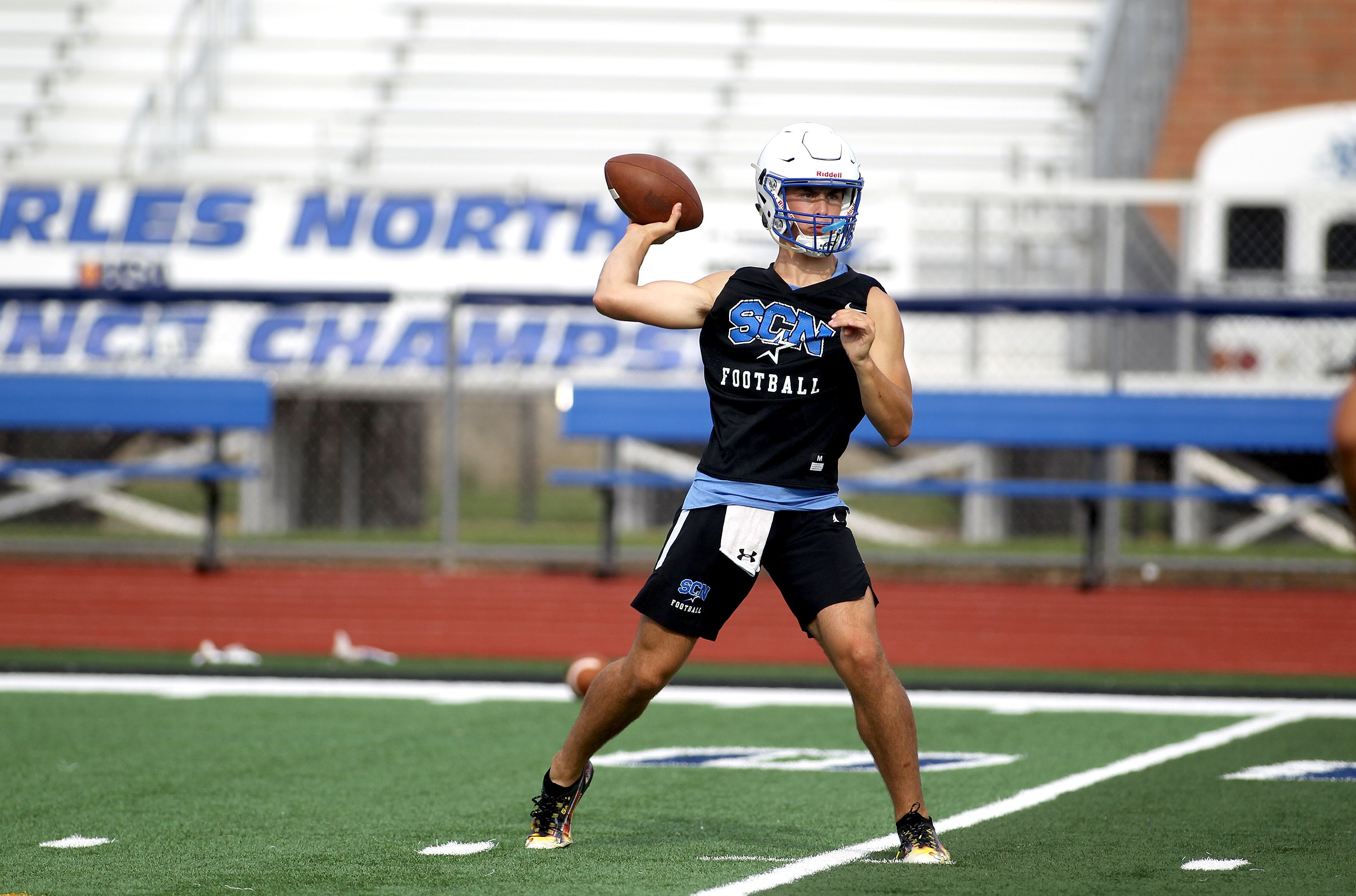 St. Charles North quarterback Ethan Plumb throws the ball during a practice at the school on Monday, Aug. 23, 2021.