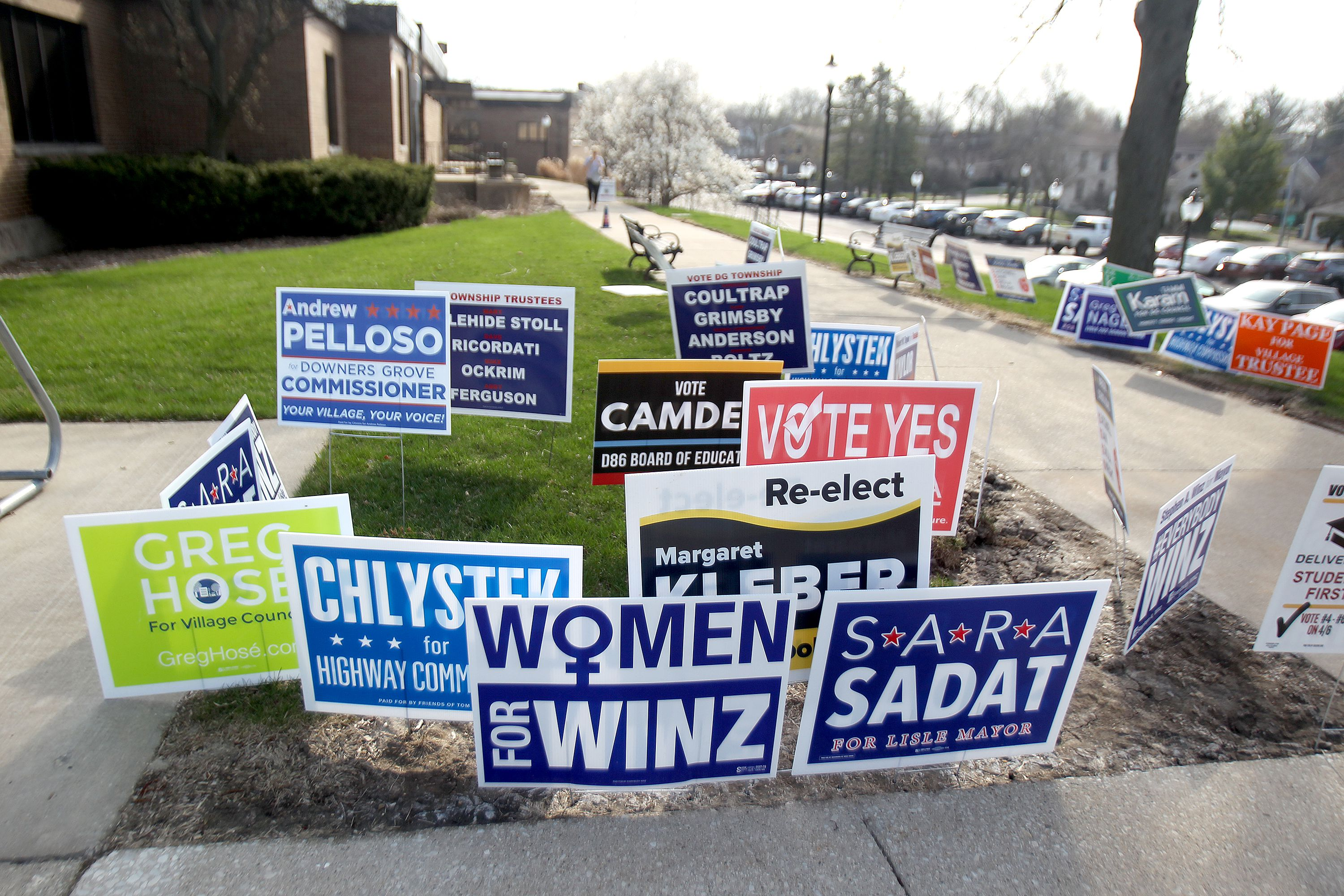 Campaign signs outside the Downers Grove Village Hall on Tuesday, April 6, 2021.