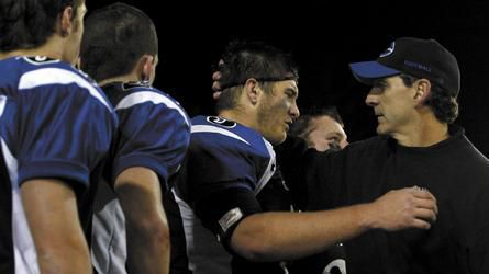 Geneva senior defensive lineman Cory Hofstetter (center) is embraced by coach Rob Wicinski after the Vikings' 33-14 loss to East St. Louis in the 2008 Class 7A football state championship game at the University of Illinois' Memorial Stadium in Champaign.