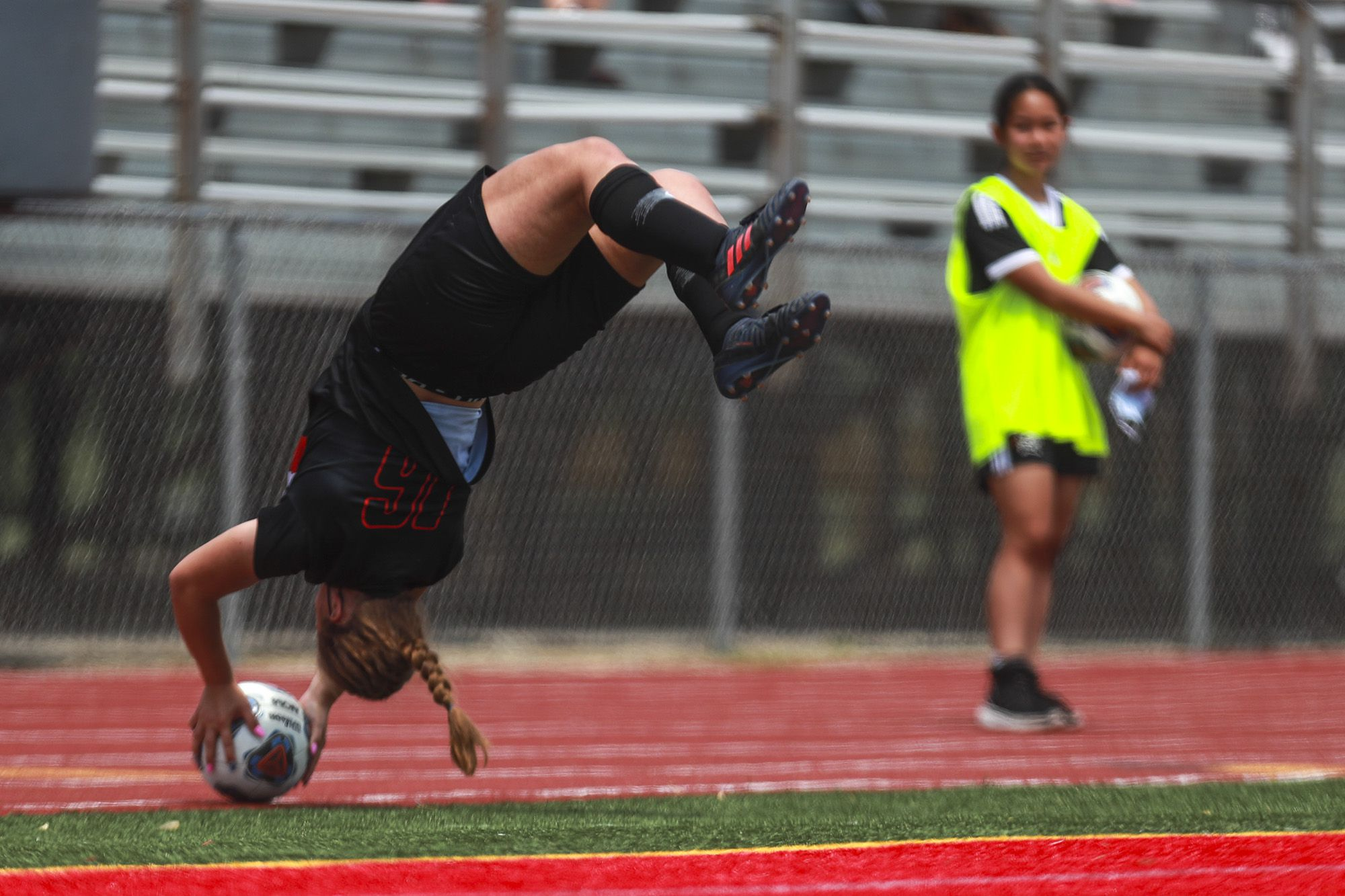 Lincoln-Way Central midfielder Grace Grundhofer launches the ball into the box from a flip throw-in on Saturday, May 22, 2021, at Lincoln-Way East High School in New Lenox, Ill.
