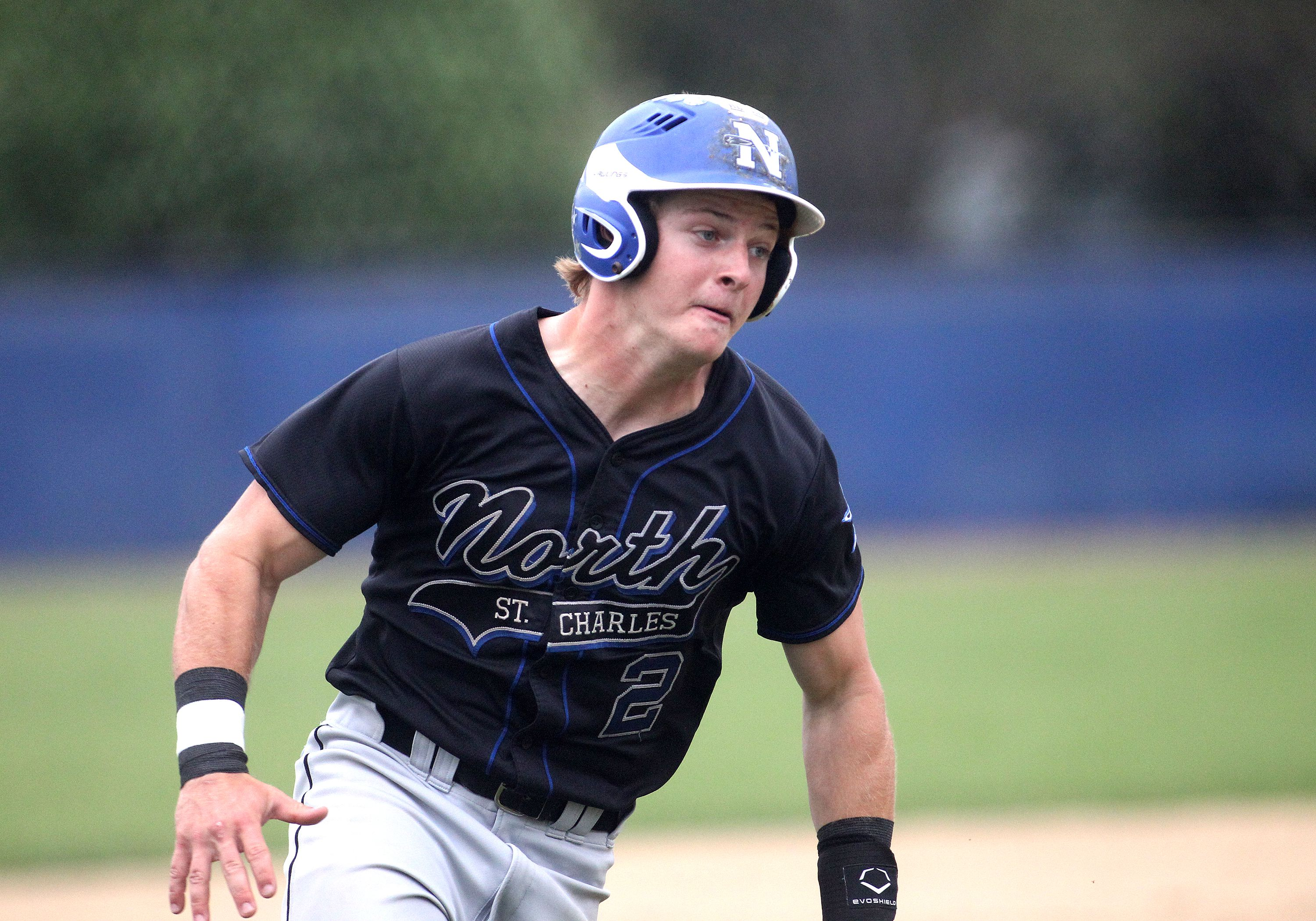 St. Charles North's Nick DeMarco runs home during a game at Geneva High School on Monday, May 3, 2021.