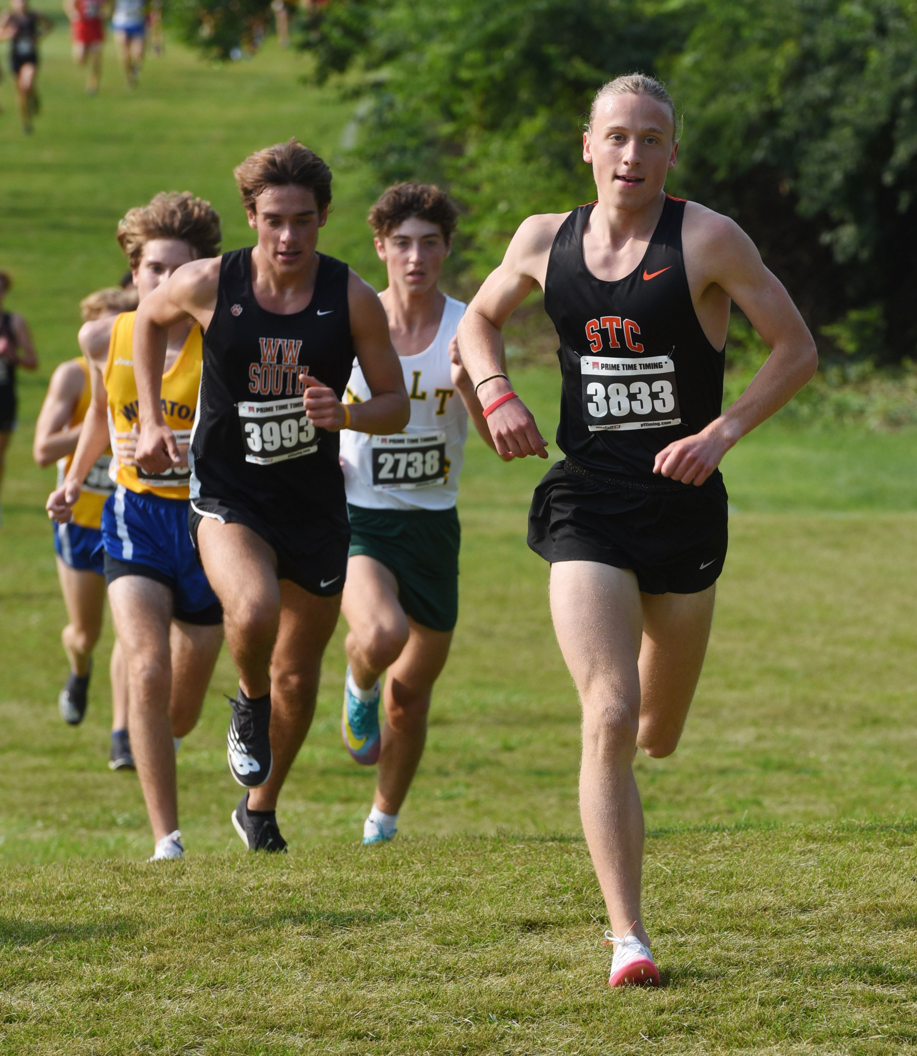 Joe Lewnard/jlewnard@dailyherald.com Micah Wilson of St. Charles East is out in front as he runs toward a first-place finish during the Lake Park cross country invite in Roselle Saturday.