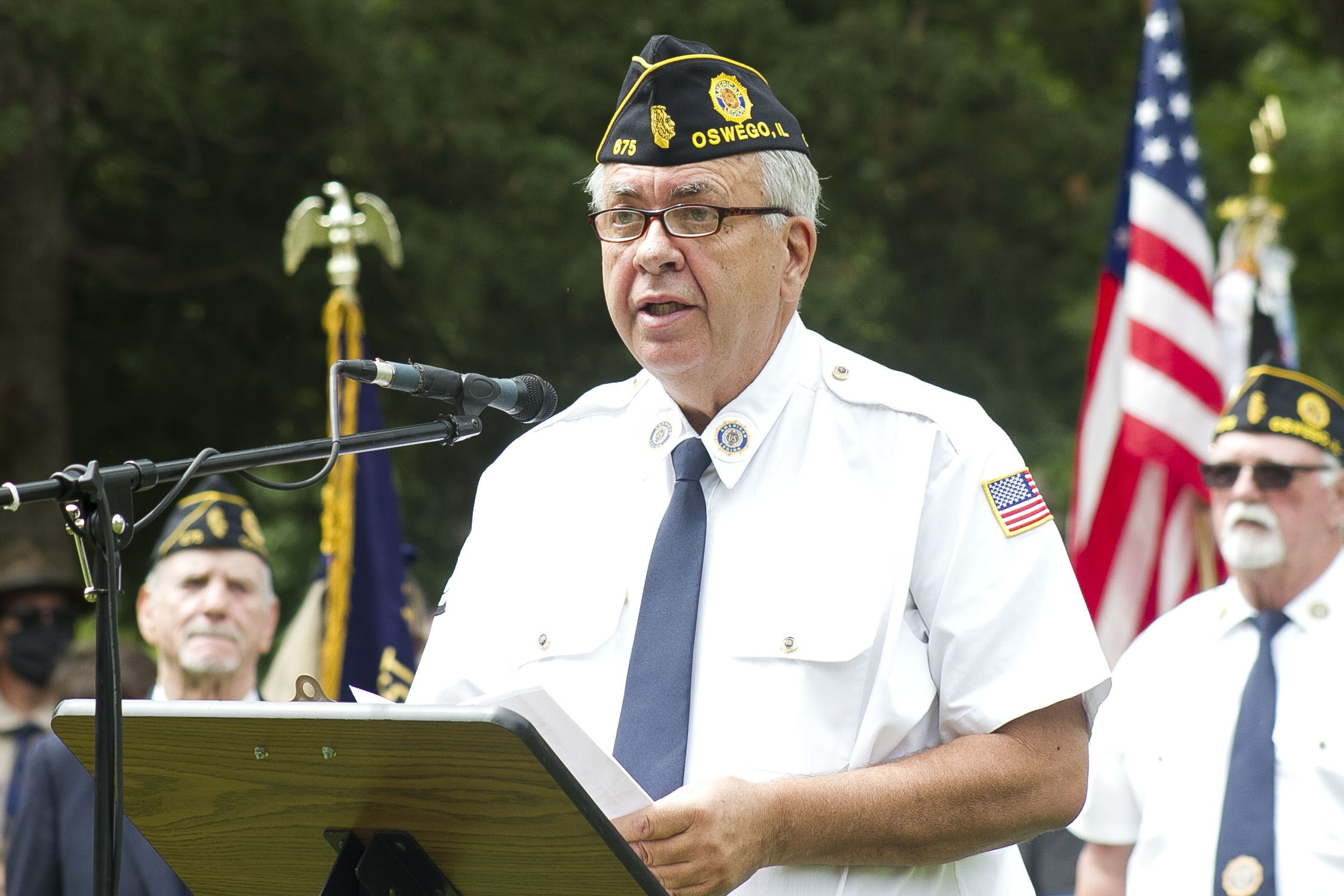 Oswego American Legion Post 675 Commander Joe West welcomed crowds to the Oswego Township Ceremony to observe the annual Memorial Day ceremony, following a parade through downtown Oswego.