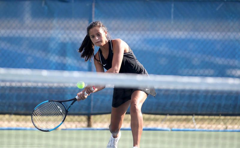 Maddie Hoden of St. Francis plays with doubles partner Taylor Austin (not pictured) during a home match against Lisle on Aug. 27.