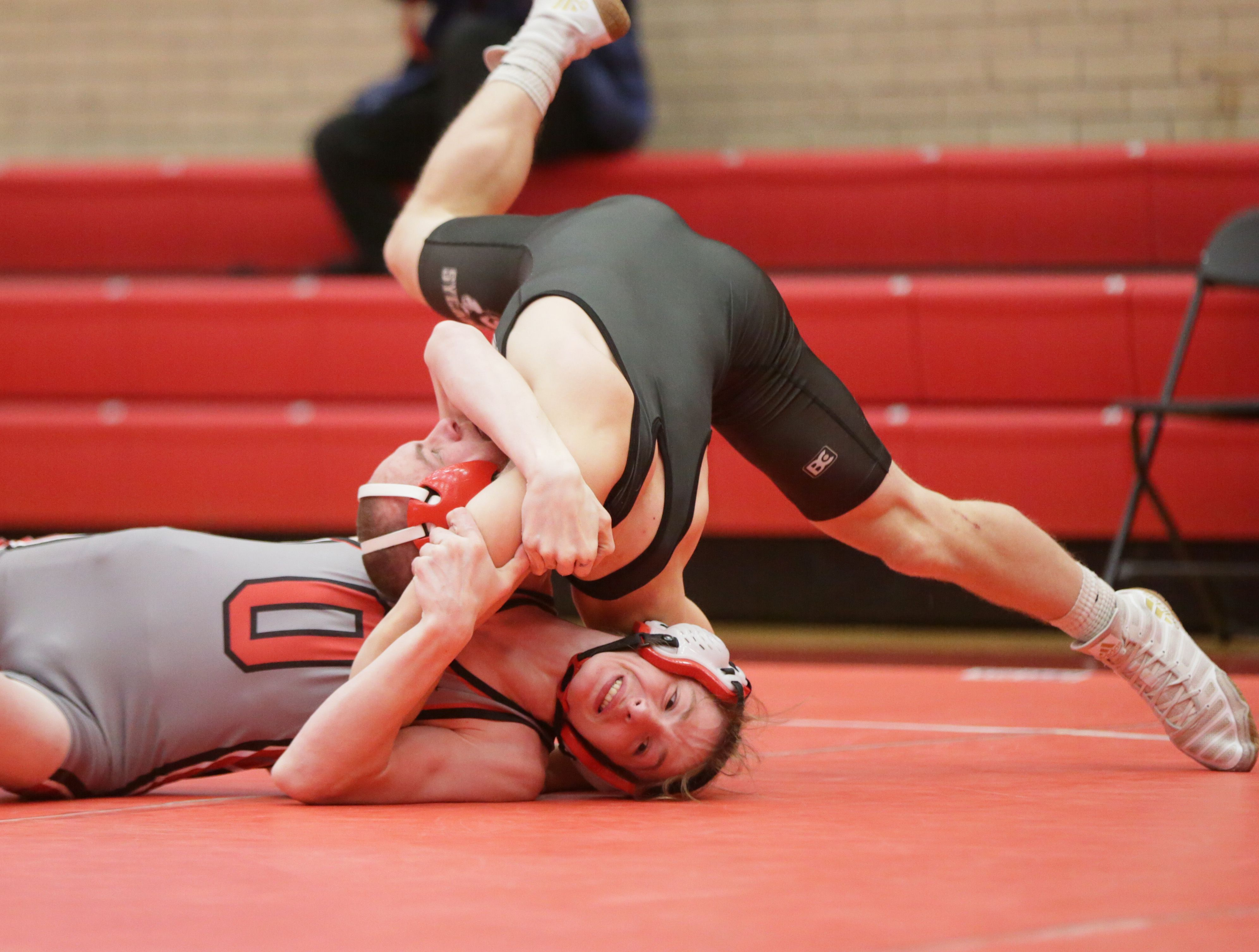 Ottawa's Tristan Simmons flips Sycamore's Samuel Sprinkle during a wrestling meet at Ottawa on Saturday May 1, 2021.