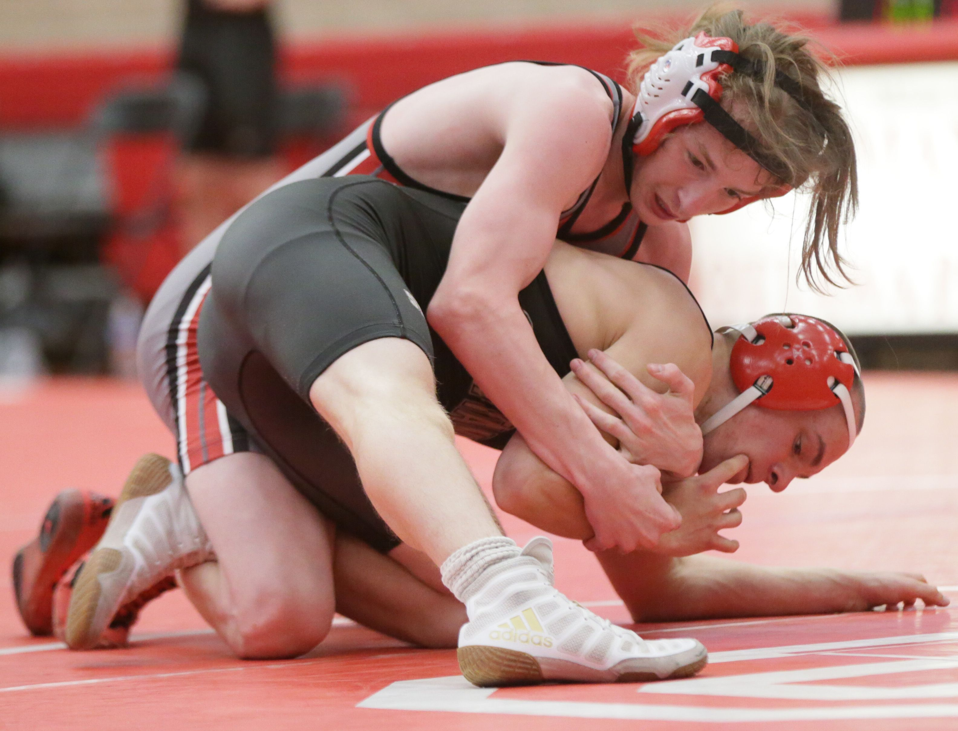 Ottawa's Tristan Simmons, wrestles Sycamore's Samuel Sprinkle, during a wrestling meet at Ottawa on Saturday May 1, 2021.