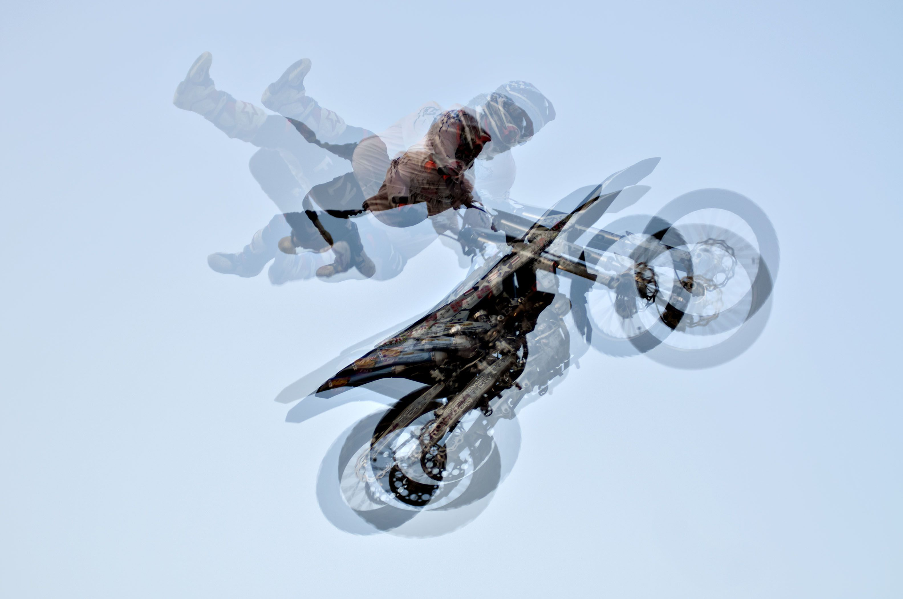 In a multiple exposure image, motocross rider Scott Murray does some aerial acrobats during the Sick Air FMX show at the Whiteside fair.