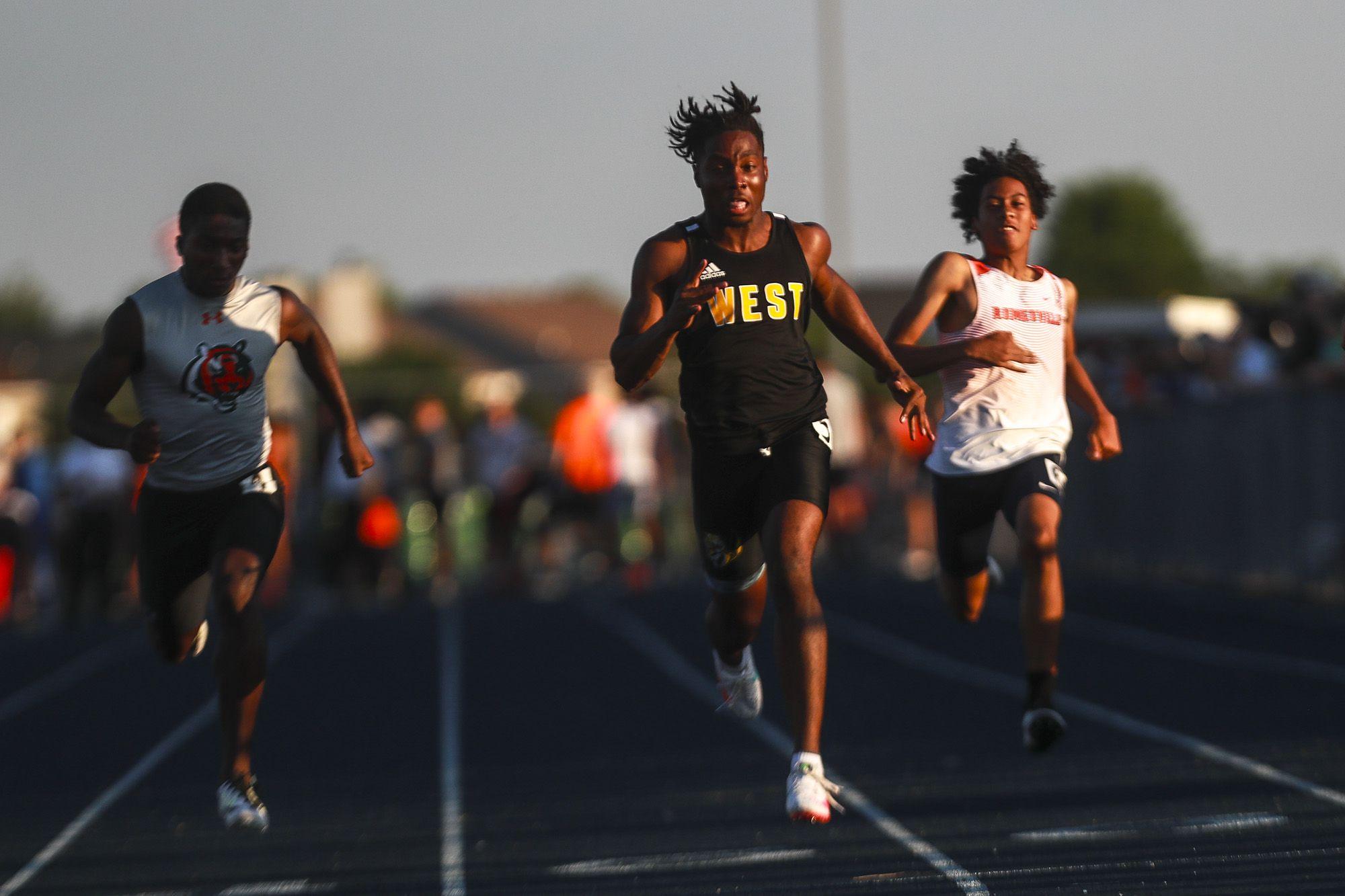 Joliet West sprinter Robert Satterwhite powers through the finish on Saturday, June 5, 2021, at Plainfield South High School in Plainfield, Ill.