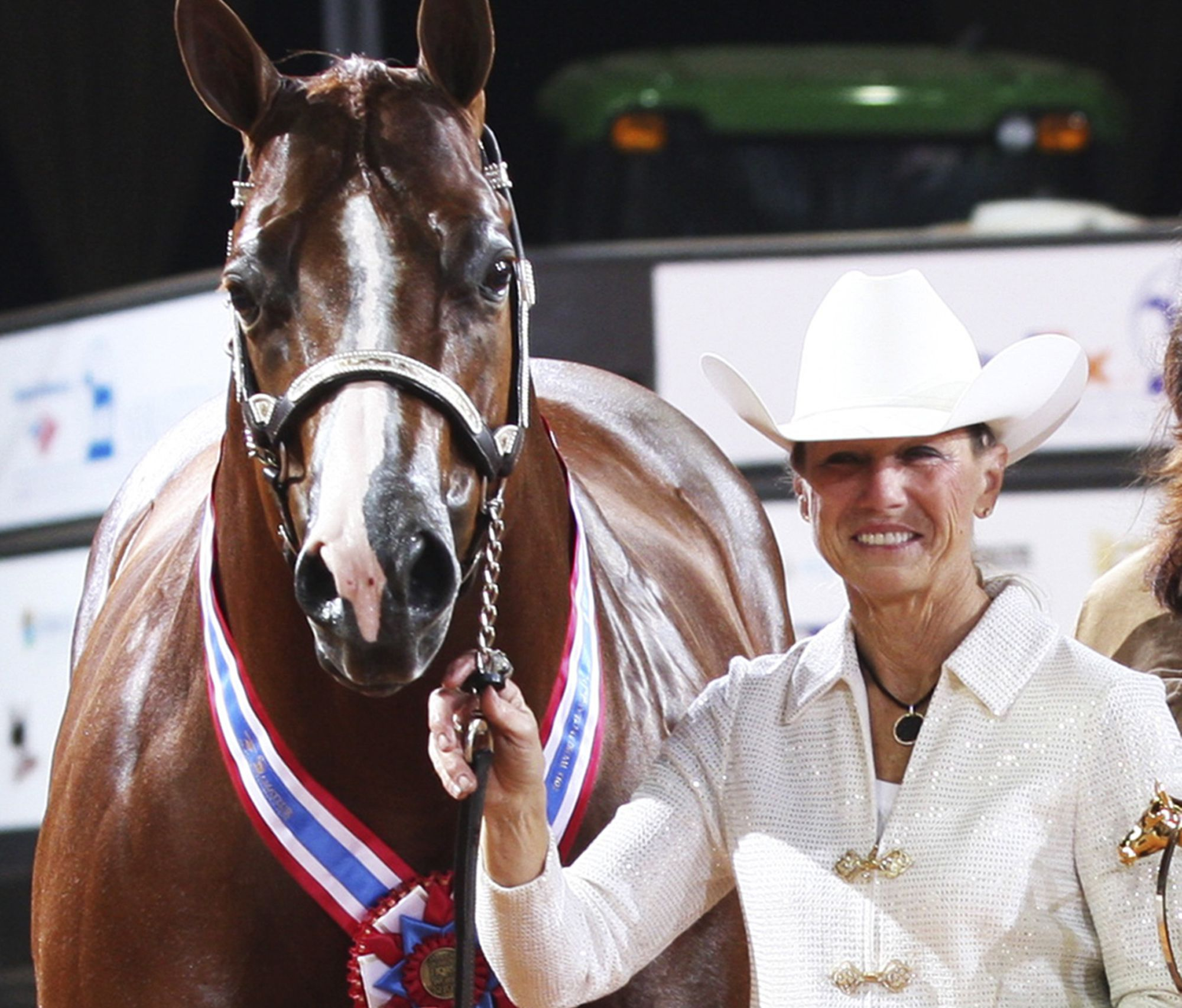 This November 2011 photo shows Rita Crundwell, of Dixon, Ill., posing with Pizzazzy Lady at the 2011 American Quarter Horse Association World Championship Show in Oklahoma City. Crundwell is accused stealing $53 million from the city in northern Illinois by siphoning public funds into a secret bank account opened in 1990 while she was Dixon's comptroller. A judge on Thursday, May 3, 2012, granted the government's request for forfeiture of the 311 animals owned by Crundwell, which are now in the care of U.S. marshals. Federal prosecutors contend she used the funds to sustain a lavish lifestyle and her horse breeding operation. Crundwell was regarded as one of the best horse breeders in the country.