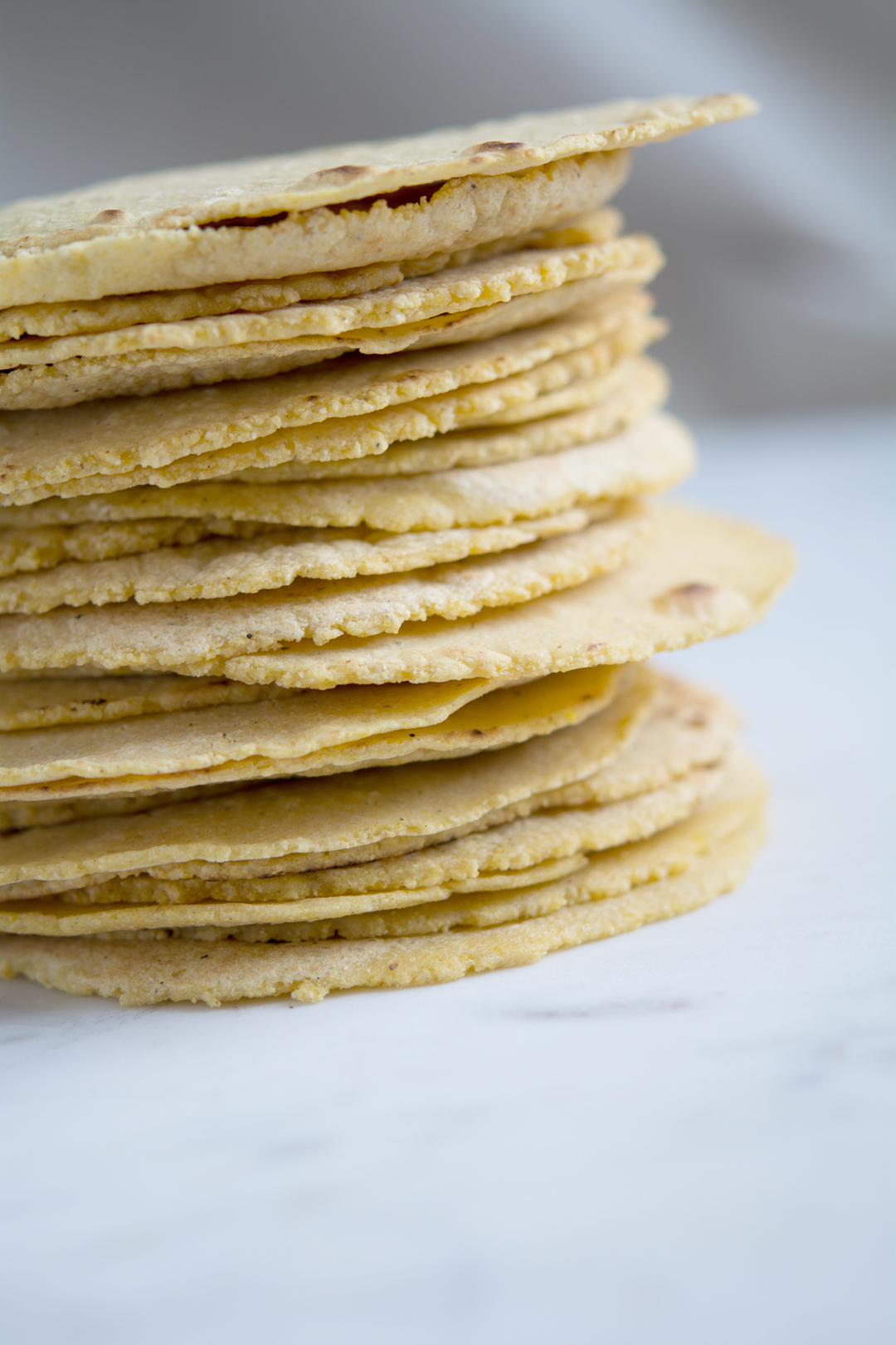 a stack of homemade tortillas, sideview