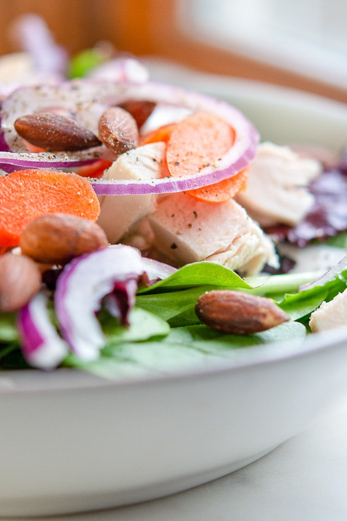 green salad with carrots, almonds and red onion and homemade ranch dressing