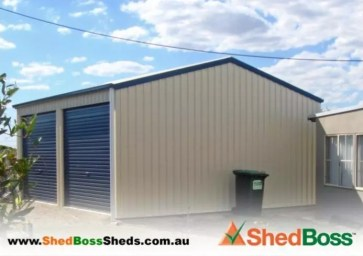 Gable shed 6Lx6Wx2.7H with a 15 degree roof pitch. Colorbond™ roof and walls in Classic Cream; trim and roller door Deep Ocean