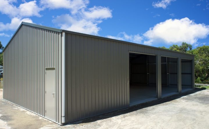 Shed Boss Gable shed, 14Lx9Wx3.4H. Featuring COLORBOND Woodland Grey™  roof and trim, with Gully™  walls and roller doors. Each of the roller doors has a daylight opening of 3m x 3m, allowing plenty of room for the boat or caravan.  Council approval, concrete and construction all taken care of by the team at Shed Boss Fleurieu, a licensed builder.