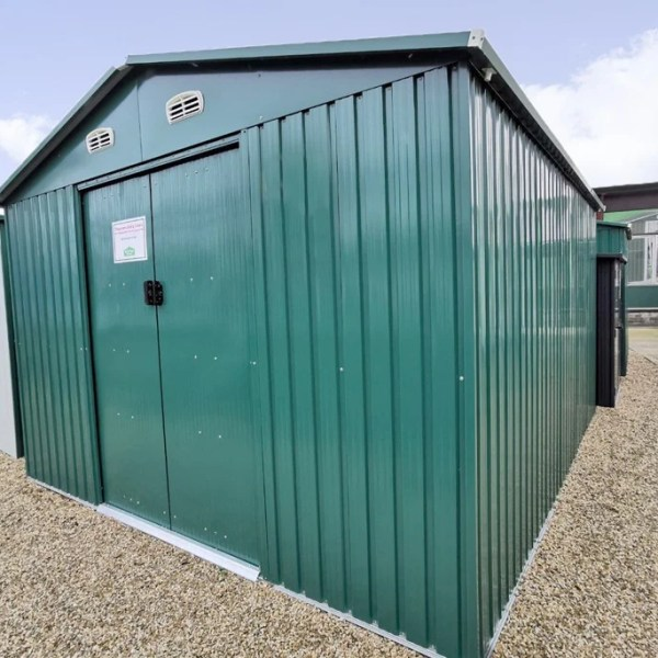 The green colossus shed as seen on the Sheds Direct Ireland showroom lot. It's seen from a low angle and it's a dark shade of green.
