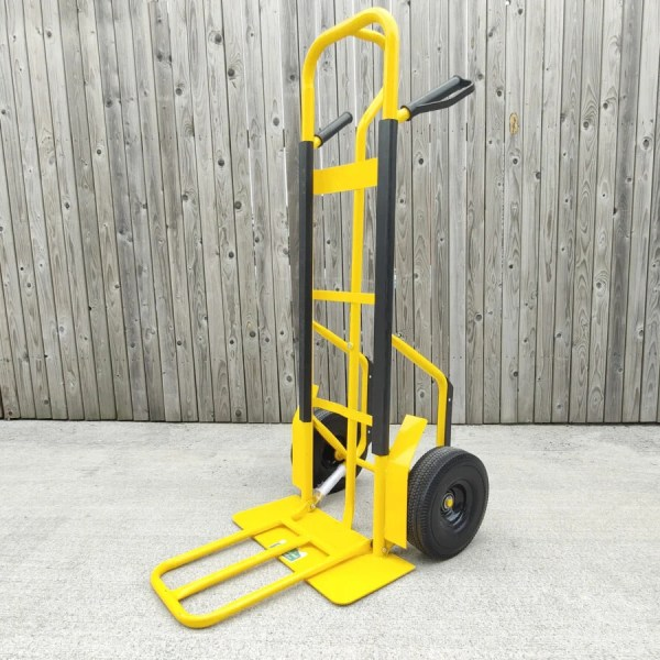 The Yellow Industrial Hand truck with extendable footplate against a wooden wall