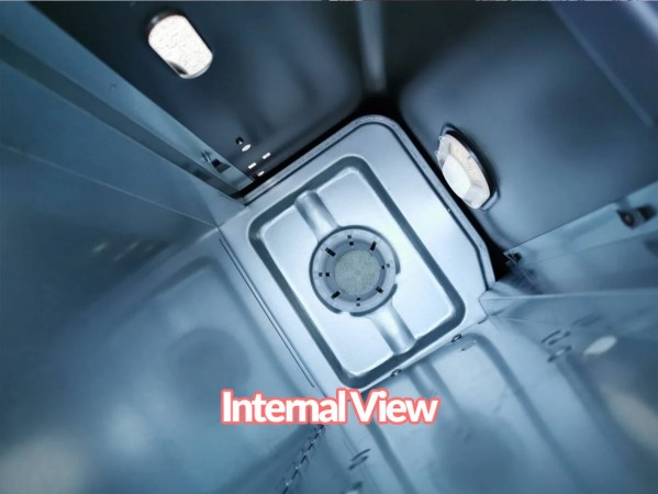 The internal view of the powerful heater, the kero 4600. It's a blue-si;lver colour and sleek in it's construction. There is a reservoir for fuel at the bottom. Two clear displays allow the user to see the fuel level through the body of the machine