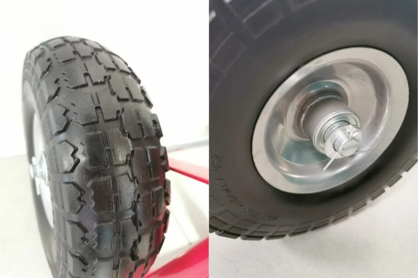 The wheel detail on the red sack truck. The photos are taken close up. There are two photos connected together in this one image. The one on the left shows the grip on the tyres. They are shaped almost like teeth and they are cut deep into the tyre. The photo on the left shows the internal wheel mechanism, with ball bearings. It's bright silver.