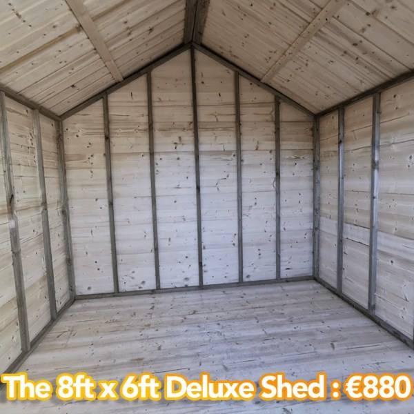The 8ft x 6ft deluxe shed as seen from inside. The walls are a pale colour and the whole interior is wooden.