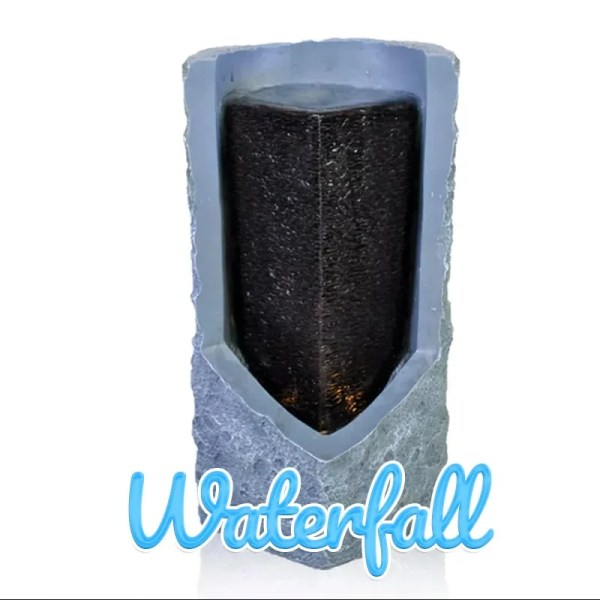 The Waterfall Water feature is perhaps the most unusual looking. It is a cuboid shape which has a jagged pyramid shaped cut into it, which exposes the inner core. The core is a black rectangular mass which water runs down