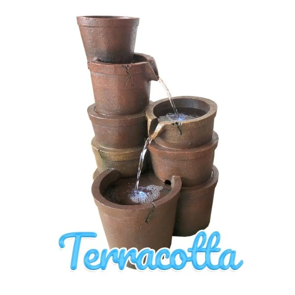 Three stacks of Terracotta pots stand together. THe first stack is 5 pots high, the second is 3 and the last is a single pot. Water flows downwards through them.