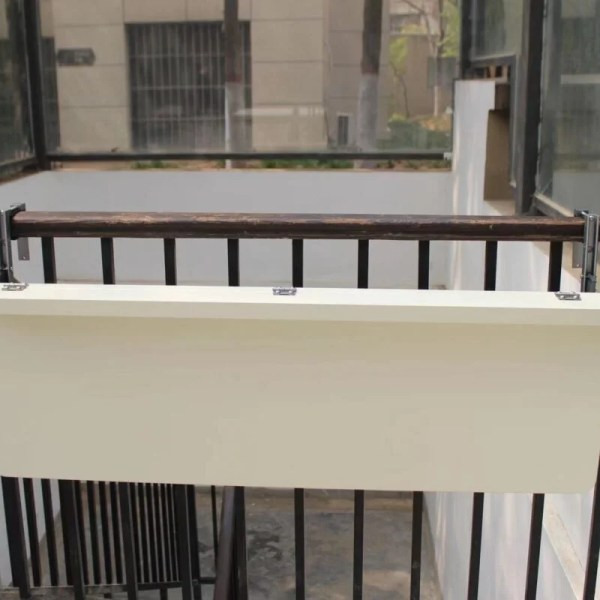 The White balcony railing table in the down position