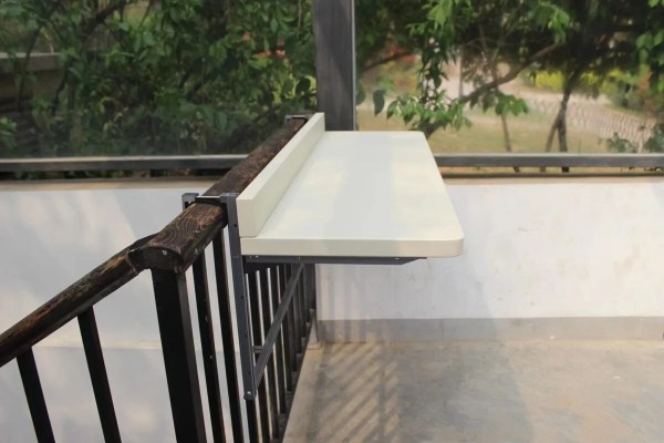 A 90 degree view of the large white railing table