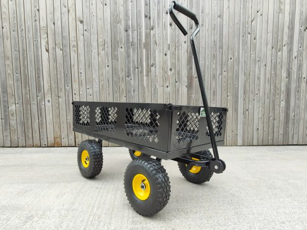 The black mesh cart from Sheds Direct Ireland against a wooden wall