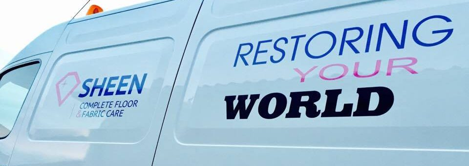 This is a picture of the side of our clean, white, shiny van with company logo and our slogan 'Restoring Your World'