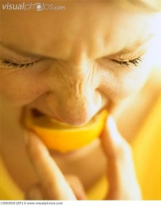 Woman Biting Lemon Slice