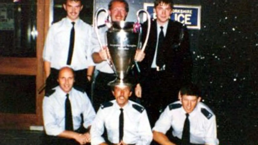 South Yorkshire Police officers pose for photo with stolen European Cup at West Bar police station