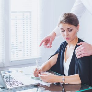boss puts hand on employees shoulder