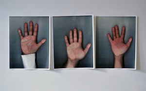 three photographs of hands