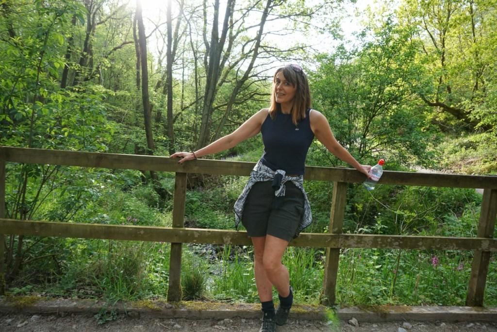DiscoDeb posing on a bridge
