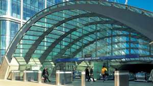 The arched, glazed roof of Canary Wharf Station in London provides an airy canopy for the escalators leading down to the platforms.