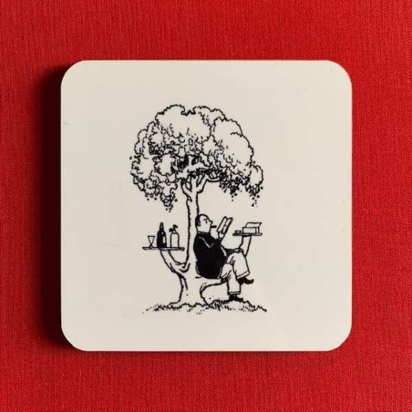 Photograph of a coaster, illustrated with the Well-Trained Tree black and white line drawing by Heath Robinson.